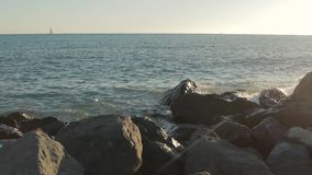 Rocky shore with rushing tidal sea waves. stock footage