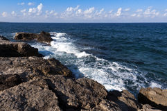 Rocky shore and sea Stock Photos