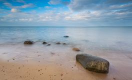 Rocky shore of sea. Long exposure seascape. Royalty Free Stock Photos