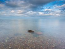 Rocky shore of sea. Long exposure seascape. Royalty Free Stock Photo