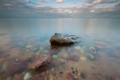 Rocky shore of sea. Long exposure seascape. Stock Photos