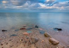 Rocky shore of sea. Long exposure seascape. Stock Image