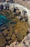 Eroded Shore Cliff, Turquoise Water stock images