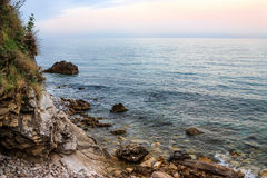 Rocky shore and sea sunset Royalty Free Stock Photography