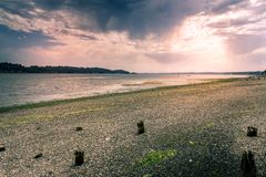 Sunset glow over rocky shore Royalty Free Stock Images