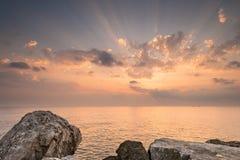 Rocky shore during sunrise. In Tsilivi Zakinthos Greece Stock Photo