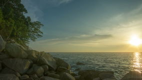 Rocky shore of tropical ocean at sunset Royalty Free Stock Image
