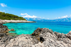 Rocky shore with turquoise sea water Stock Photo