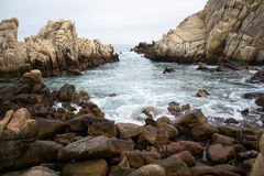 Rocky shore in Ulsan. Wave running on rocky shore near Ulsan Stock Image