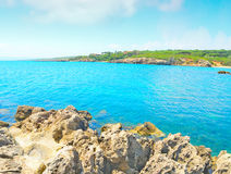 Rocky shore under clouds Royalty Free Stock Photography