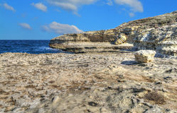 Rocky shore under clouds in Sardinia Royalty Free Stock Photos