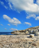 Rocky shore under clouds in Sardinia Royalty Free Stock Photography