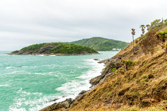 Rocky shore under cloudy sky in Phuket, Thailand.  Stock Image