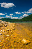 The rocky shore of  Watauga Lake, in Cherokee National Forest, T Royalty Free Stock Photography