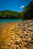 The rocky shore of  Watauga Lake, in Cherokee National Forest, T Stock Image