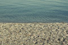 Rocky shore of water with filter effect Royalty Free Stock Photos