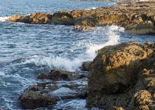 Rocky shoreline of Adriatic Sea at Borgo Ignazio Resort, Savelletri di Fasano. Pictured is a rocky shoreline at the Borgo Ignazio Resort in Savelletri Di Fasano Royalty Free Stock Images
