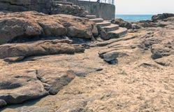 Rocky Shoreline Against Ocean Sky Coastal Landscape Stock Photo
