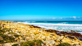 The rocky shoreline of the Atlantic Ocean between Cape of Good Hope and Platboom Beach Stock Image