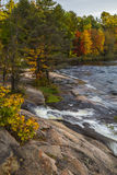 Rocky Shoreline in Autumn Stock Images