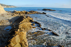 Rocky shoreline below Heisler Park, Laguna Beach, CA. Image shows the rocky shoreline below the gazebo in Heisler Park, Laguna Beach, California. Bird Rock is Stock Photography