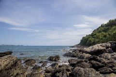Rocky shoreline and blue sky Royalty Free Stock Photography