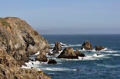 Rocky shoreline on California coast. Horizontal rocky shoreline near Bodega Bay on the California coast Royalty Free Stock Photo