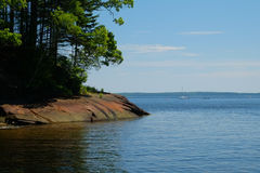 Rocky shoreline and calm cove Stock Image