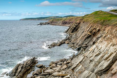 The rocky shoreline of Cape Breton Island Royalty Free Stock Images