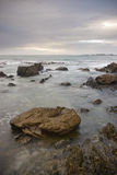 Rocky shoreline with clouds Royalty Free Stock Photography