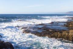 Rocky shoreline in the coast of California Stock Image