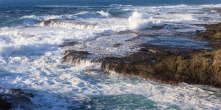 Rocky shoreline in the coast of California Stock Images