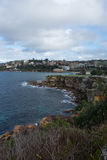 Rocky shoreline of Coogee beach. Cliff faces and waves surrounding Coogee Beach in Sydney, Australia Stock Image