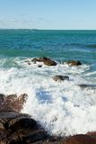 Rocky Shoreline with Crashing Water Royalty Free Stock Image