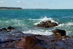 Rocky Shoreline with Crashing Water Royalty Free Stock Photography