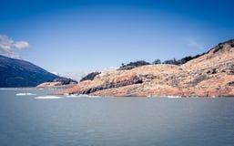 Rocky shoreline in El Calafate. Rocky shoreline on a lake in El Calafate Argentina Stock Photo