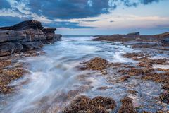 Surging Tide on Howick Coastline Stock Photography