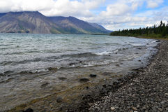 Rocky Shoreline of Kathleen Lake in Yukon Territory, Canada Stock Photo