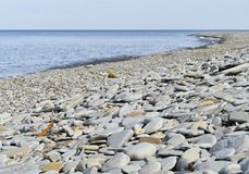 Rocky shoreline beside a lake. Rocky shoreline beside Lake Erie in Pennsylvania Stock Photo