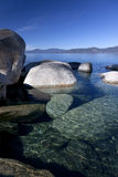 Rocky Shoreline, Lake Tahoe. Crystal clear water and rocky shoreline, morining, Lake Tahoe, USA Royalty Free Stock Photography