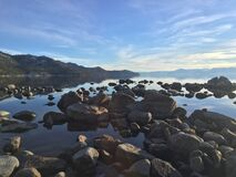 Rocky shoreline of Lake Tahoe Stock Images