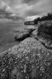 Rocky Shoreline. Landscape featuring a rocky shoreline.  Monochrome image Stock Image