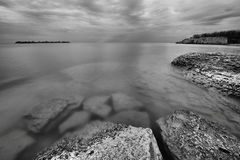 Rocky Shoreline. Landscape featuring a rocky shoreline.  Monochrome image Royalty Free Stock Images
