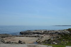 Rocky Shoreline. The rocky shoreline of Maine overlooks the Atlantic Ocean Stock Photo