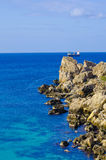 Rocky shoreline, Malta. Rocky shoreline in the northern part of Malta surrounded by crystal clear blue lagoon Royalty Free Stock Image