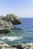 Rocky Shoreline. Rocky Mediterranean shoreline against a deep blue sea Stock Image