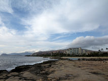 Rocky shoreline next to lagoon at Ko Olina Royalty Free Stock Photography