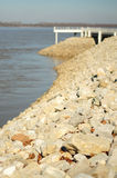 Rocky shoreline by ocean Stock Photos