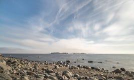 Rocky Shoreline over Ocean Stock Photo