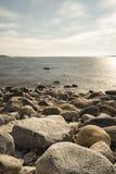 Rocky Shoreline over Ocean Royalty Free Stock Photo